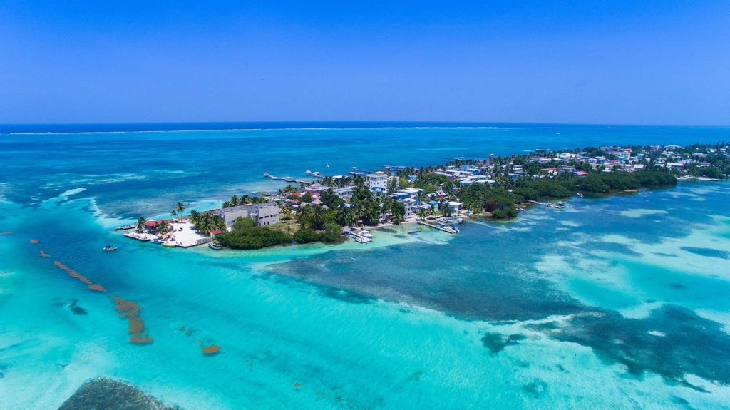 Caye Caulker Also Known As La Isla Cariñosa Is Separated By Roximately One Mile Of Blue Water From The Second Largest Barrier Reef In World